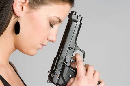 finger on trigger: Gun Woman LANG_EVOIMAGES