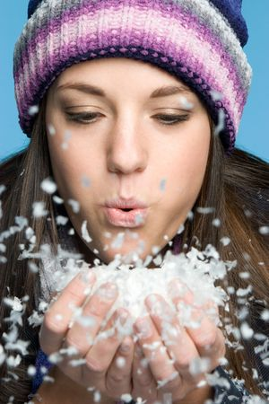 Woman Blowing Snow Stock Photo - 5788582