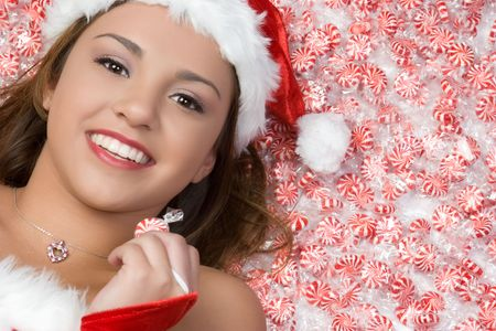 mrs santa claus: Christmas Girl Laying in Candy LANG_EVOIMAGES