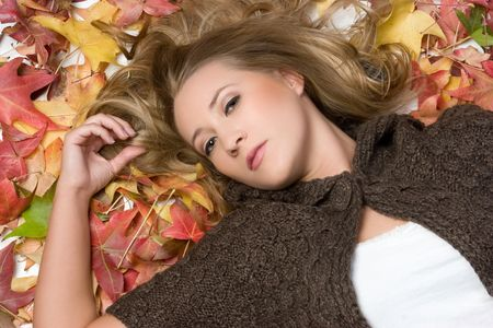 Woman Laying in Leaves Stock Photo - 5788530