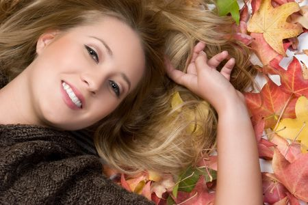 lying in leaves: Smiling Autumn Woman