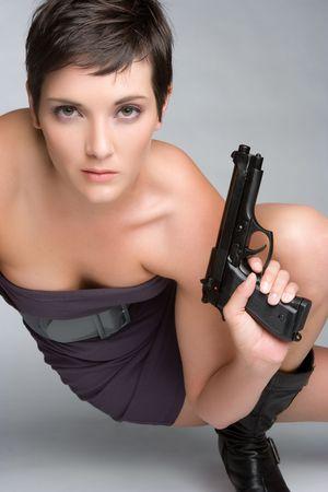 Sexy Spy Woman Holding Gun Stock Photo - 5788540