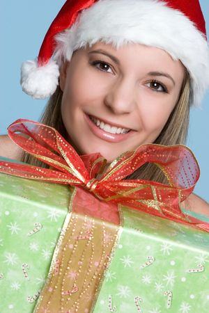 mrs santa claus: Woman Holding Christmas Present LANG_EVOIMAGES
