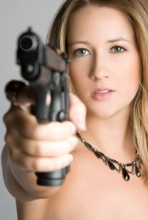 firearms: Woman Pointing Gun Stock Photo