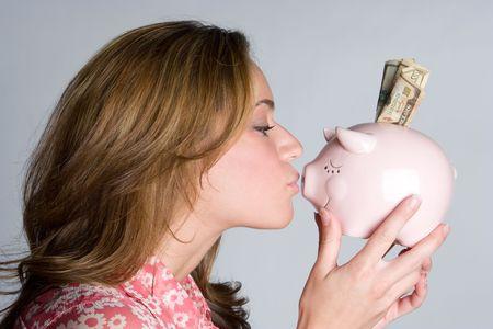 Woman Kissing Piggy Bank Stock Photo - 5844883