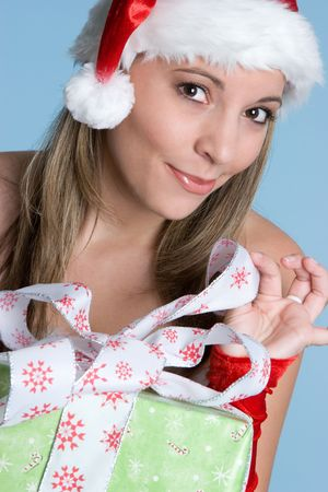 Woman Opening Christmas Gift Stock Photo - 5844898