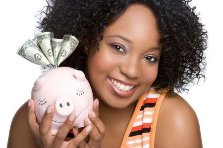 american curl: Black Woman Holding Piggy Bank LANG_EVOIMAGES