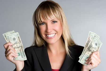 Businesswoman Holding Money Banco de Imagens