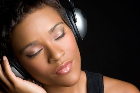eye  closed: Black Woman Wearing Headphones
