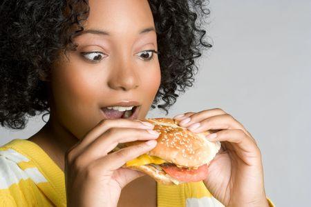 adult sandwich: Woman Eating Cheeseburger