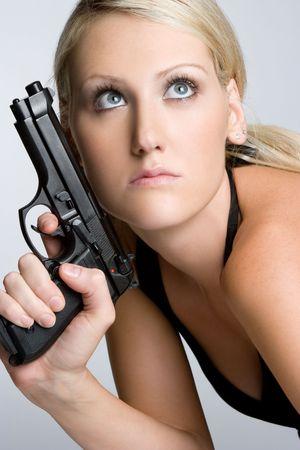 Sexy Woman Holding Gun Stock Photo - 6059248