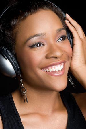 Black Girl, het dragen van de hoofd telefoon  Stockfoto