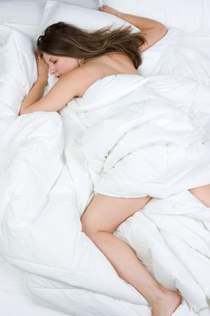 Woman Sleeping in Bed Stock Photo - 6083320