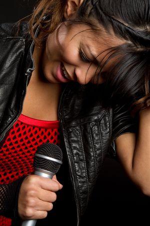 Singing Hispanic Girl Stock Photo - 6171400