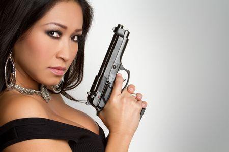 Sexy Woman Holding Gun Stock Photo - 6270681