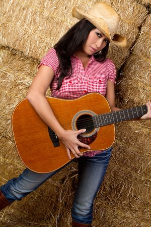 Asian Woman Playing Guitar Stock Photo - 6307084