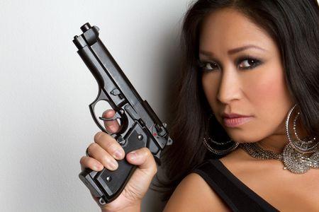 Gorgeous Woman Holding Gun Stock Photo - 6307112