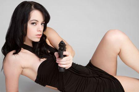 Gun Woman Lying Down Stock Photo - 6307123