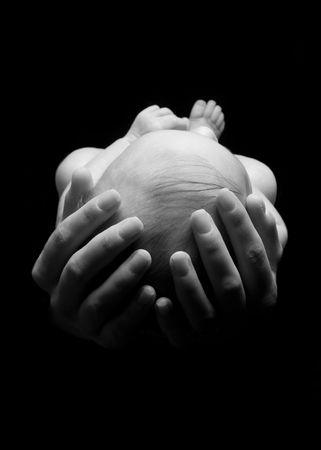 Baby in Hands Stockfoto