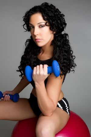 Fitness Woman Lifting Weights LANG_EVOIMAGES