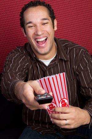 tv remotes: Popcorn Man Watching TV