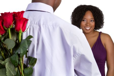 gift behind back: Man Giving Woman Roses LANG_EVOIMAGES