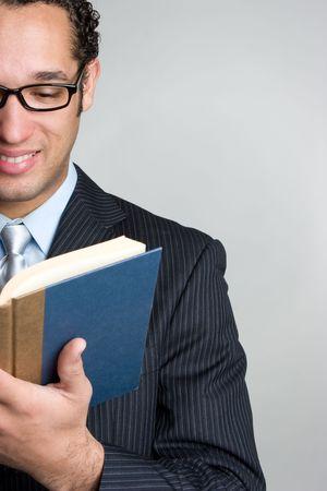 black rimmed: Businessman Reading Book LANG_EVOIMAGES