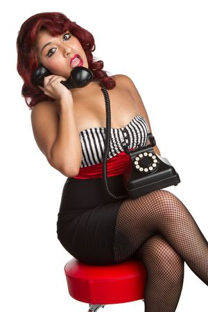 Pinup Woman Using Vintage Phone Stock Photo - 6501347