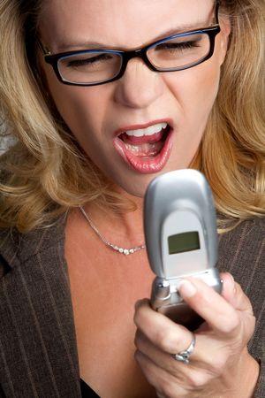Woman Yelling into Phone Stock Photo - 6521186