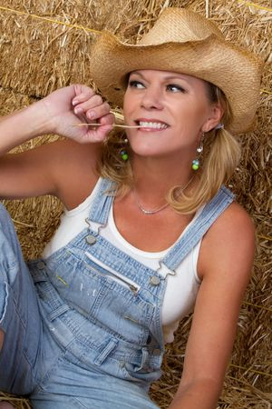 Country Woman in Barn Stock Photo