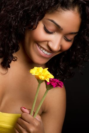 smilling: Woman Holding Flowers