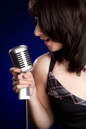 Singing into Elvis Microphone Stock Photo - 6736394