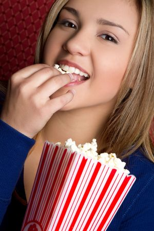 Girl Eating Popcorn Stock Photo - 6763155