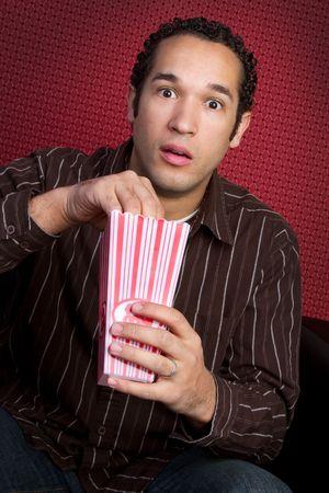 Man Eating Poopcorn Stock Photo - 6775295