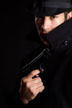 Man Holding Gun photo
