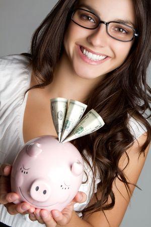Businesswoman Holding Piggy Bank