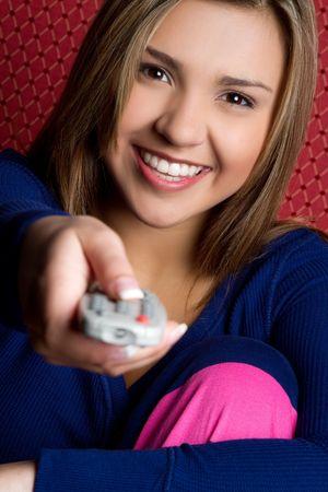 tv remote: Girl Holding TV Remote