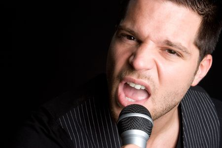 Man Singing in Microphone Stock Photo - 6814075