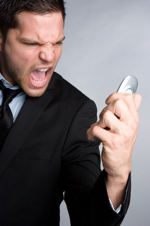 Yelling Cell Phone Businessman photo