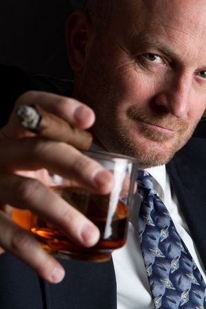 cigar smoking man: Man Drinking and Smoking