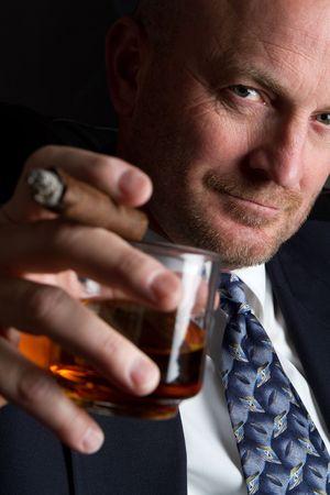 cigars: Man Drinking and Smoking