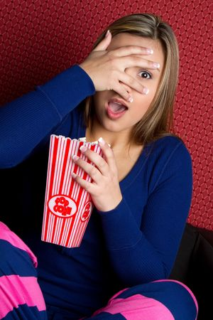 Scared Girl Watching Movie Stock Photo - 6866702