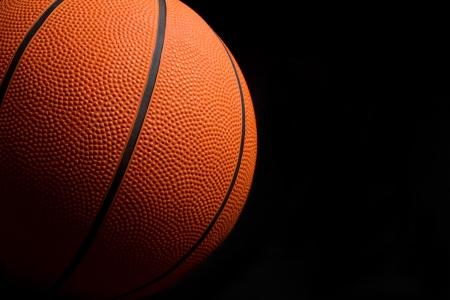 lowkey: Basketball on Black Background Stock Photo