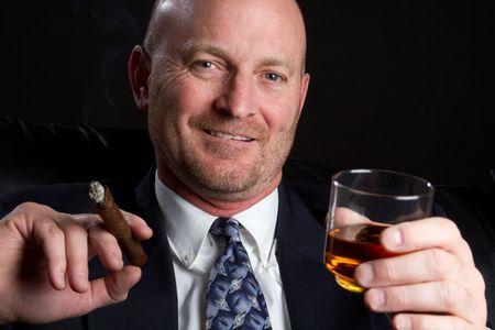 cigars: Man Smoking and Drinking LANG_EVOIMAGES