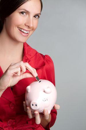 Piggy Bank Woman Smiling Stock Photo - 9105728