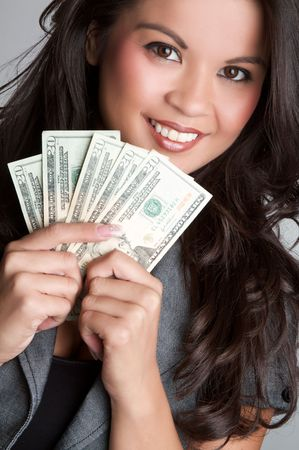 american money: Businesswoman Holding Money LANG_EVOIMAGES