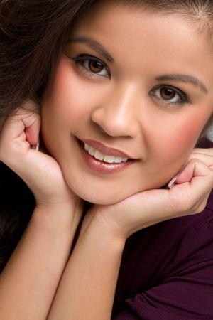 chin on hands: Beautiful smiling filipino woman