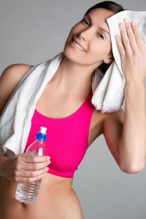 hand towel: Fitness woman holding water bottle