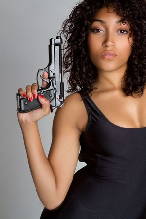 firearm: Sexy black woman holding gun