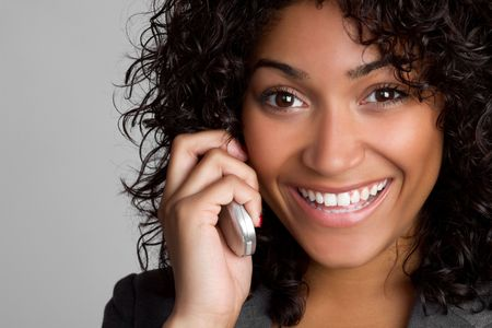 Smiling black woman on phone